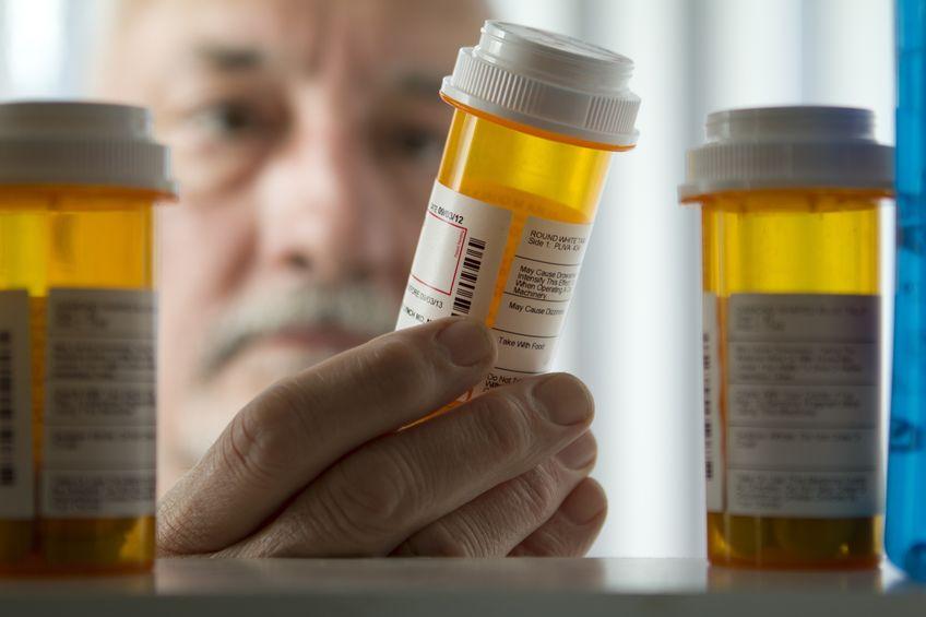 Senior man reading prescription label